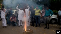 Congress party supporters light crackers outside the residence of their leader Rahul Gandhi as they celebrate his return from holidays in New Delhi, India, April 16, 2015.