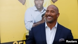 """Cast member Dwayne Johnson poses at the premiere of the movie """"Central Intelligence"""" in Los Angeles, California, June 10, 2016."""