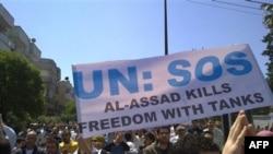 Humus'ta Birleşmiş Milletler'i yardıma çağıran protestocular