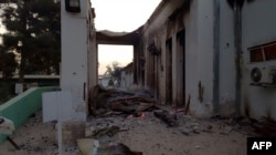 In this photograph released by Medecins Sans Frontieres (MSF) on Oct. 3, 2015, fires burn in part of the MSF hospital in the Afghan city of Kunduz after it was hit by an airstrike.