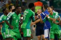 Nigeria's Peter Odemwingie (R) celebrates with teammates after scoring a goal against Bosnia during their 2014 World Cup Group F soccer match at the Pantanal arena in Cuiaba June 21, 2014. REUTERS/