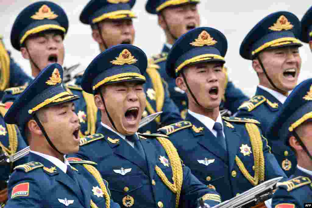 Military honor guards attend a welcome ceremony of French President Emmanuel Macron at the Great Hall of the People in Beijing.