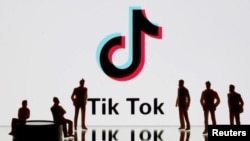In this file photo, 3-D printed figures are seen in front of a display of a Tik Tok logo in this picture illustration taken November 7, 2019. Picture taken November 7, 2019. REUTERS/Dado Ruvic/Illustration
