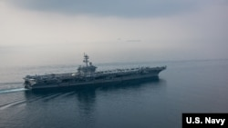 The aircraft carrier USS Carl Vinson (CVN 70) transits the Sunda Strait. The Carl Vinson Carrier Strike Group is on a regularly scheduled Western Pacific deployment.