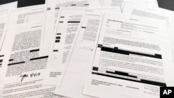 Copies of the memos written by former FBI Director James Comey are photographed in Washington, April 19, 2018.
