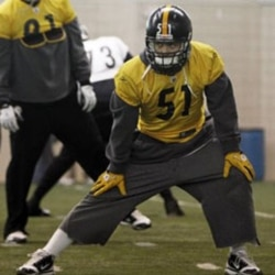 Pittsburgh linebacker James Farrior stretches during practice Thursday