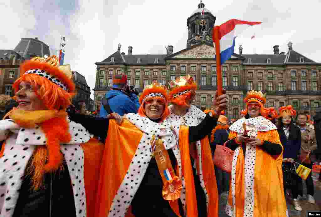 People celebrate the new Dutch King Willem-Alexander who succeeds his mother Queen Beatrix, in Amsterdam's Dam Square, the Netherlands.