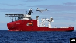 In this April 9, 2014 photo provided by the Australian Defense Force, the Australian Defense vessel Ocean Shield drops sonar buoys to assist in the acoustic search of the missing Malaysia Airliner.