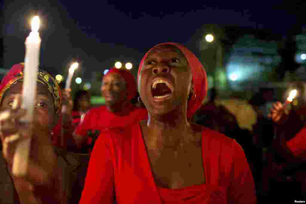 A woman shouts during a vigil in Abuja calling for the release of Nigerian schoolgirls abducted in the remote village of Chibok.