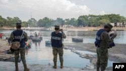Mexican Marines patrol the banks of the Suchiate River in Ciudad Hidalgo, Chiapas state, Mexico, on January 17, 2021 as a new migrant caravan is expected to get to the Mexican border with Guatemala.