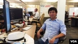 Tang Kengsreng, 29, is software engineer works at his desk at the headquarters of Cisco Systems, a technology company, in San Jose, September 1, 2016. Originally from Cambodia's Thbong Khmum province, Kengsreng has been working in Silicon Valley for over two years and is one of the few young professionals from Cambodia who have made it to the world's technology capital. (Sophat Soeung/VOA Khmer)