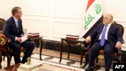 FILE - A handout picture by the Iraq Prime Minister's Press Office shows Iraqi Prime Minister Haider al-Abadi, right, meeting with U.S. Secretary of Defense Ash Carter in Baghdad, Oct. 22, 2016. Abadi insists Mosul can be taken by year's end.