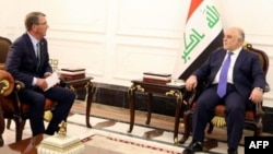 A handout picture shows Iraqi Prime Minister Haidar al-Abadi (R) meeting with U.S. Secretary of Defense Ash Carter in Baghdad, Oct. 22, 2016. Carter says he has worked out the outlines of a deal to ease tensions between Iraq and Turkey.