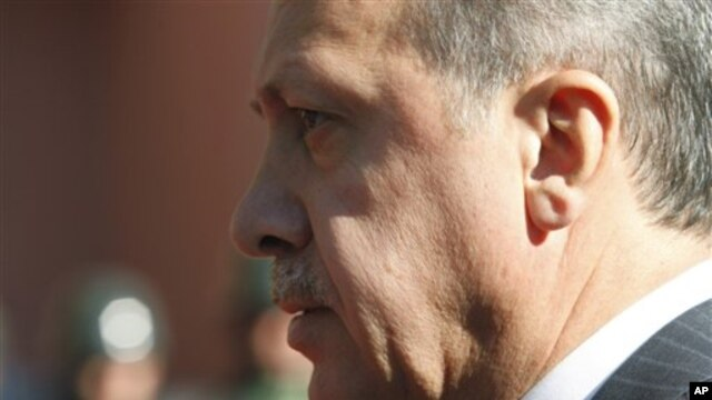 Turkish  Prime Minister Recep Tayyip Erdogan walks before a ceremony outside his office in Ankara, Turkey, Sept. 8, 2011.