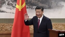 Chinese President, and General Secretary of the Communist Party Xi Jinping waves