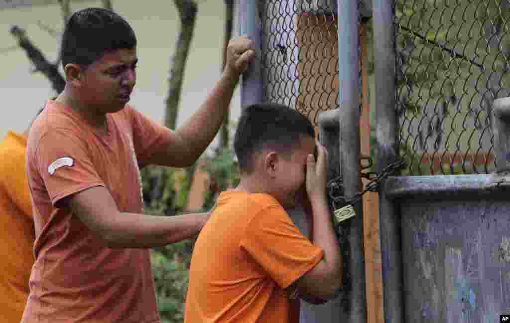 Boys cry as they find out that their sister has been killed in an earthquake in Pedernales, Ecuador. The  7.8-magnitude earthquake flattened buildings and buckled highways along its Pacific coast, sending the Andean nation into a state of emergency.