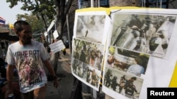 泰國反對派展示防暴警察向示威者使用暴力的照片