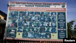 A police billboard shows a list of individuals, including the country's top militant Santoso (top L), wanted in relation with terrorism cases in Poso, Indonesia's Central Sulawesi province, Dec. 19, 2015.
