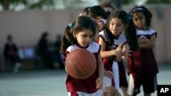 FILE - Saudi and expatriate girls practice basketball at a private sports club in Jiddah, Saudi Arabia, May. 12, 2014.