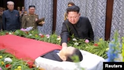 North Korean leader Kim Jong Un pays his last respects to Kim Yang Gon in this undated photo released by North Korea's Korean Central News Agency (KCNA) in Pyongyang on Dec. 31, 2015.