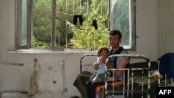 Семья беженцев в Тбилиси
