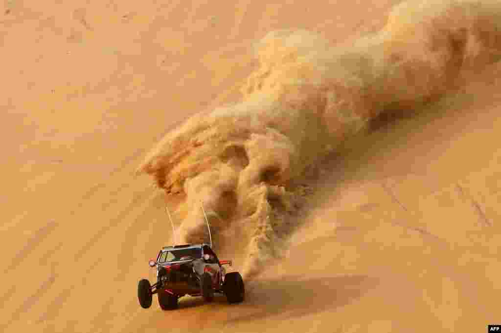 A dune buggy driver trains before competing in a drag racing event, as part of the Liwa 2016 Moreeb Dune Festival in the Liwa desert, some 250 kilometers southwest of Abu Dhabi. The festival, which attracts participants from around the Gulf region, includes a variety of races (cars, bikes, falcons, camels and horses) or other activities aimed at promoting the country's folklore.