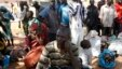 FILE - Villagers who fled the village of Gwoza, after an attack by Boko Haram in November, arrive at a camp for internally displaced people in Yola, Nigeria.