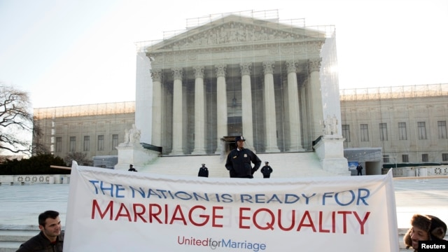 Supporters of gay marriage hold a banner as they rally in front of the Supreme Court in Washington March 27, 2013.
