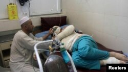 A wounded Turkish engineer receives treatment at a hospital after a suicide bomb attack in Jalalabad city, June 2, 2014.