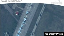 An image released by NATO on April 10, 2014 that shows fighter jets and helicopters at Primorko-Akhtarsk Air Base, Russia, near Ukraine. (DigitalGlobe/NATO ACO PAO)