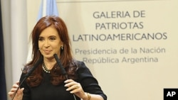 Argentina's President Cristina Fernandez de Kirchner attends a ceremony at the Casa Rosada Presidential Palace in Buenos Aires, June 21, 2011