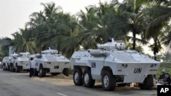UN armored personnel carriers (APC) park near the Gulf Hotel in Abidjan, 18 Dec 2010