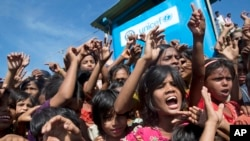 FILE - Rohingya refugee children shout slogans during a protest against the repatriation process at Unchiprang refugee camp near Cox's Bazar, in Bangladesh, Nov. 15, 2018.