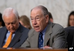 Senate Judiciary Committee Chairman Chuck Grassley, R-Iowa, joined by Sen. Orrin Hatch, R-Utah, left, opens a hearing on the Trump administration's policies on immigration enforcement and family reunification efforts, on Capitol Hill in Washington, July 31, 2018.