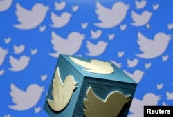 FILE - A 3-D-printed logo for Twitter is seen in this illustration, Jan. 26, 2016.