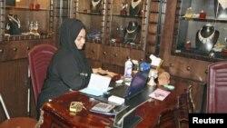 A Saudi saleswoman works at a jewelry shop in Jeddah, January 9, 2012.