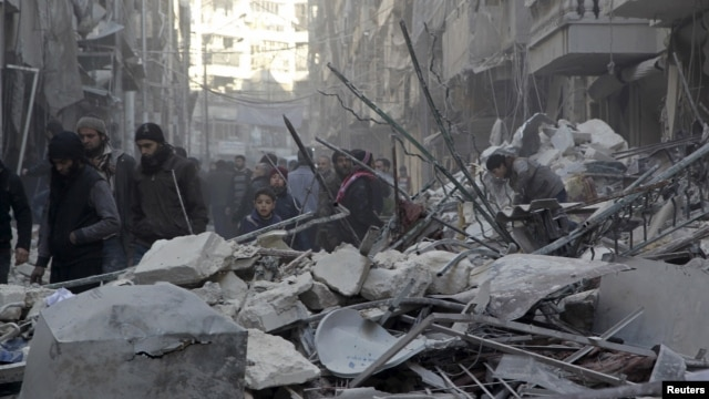 Residents inspect damage after airstrikes by Syrian government forces in the rebel-held Al-Shaar neighborhood of Aleppo, Syria, Feb. 4, 2016.