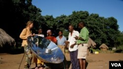 Menzies [far left] shows one of his solar cookers to villagers in Zambia (Photo: Sunfire)