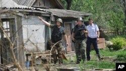 Rossiya Ukrainani Rostov oblastidagi shaharga snaryad otib, bir odamni o'ldirganlikda ayblamoqda, Rossiyaning Donetsk shahri, 13-iyul, 2014-yil