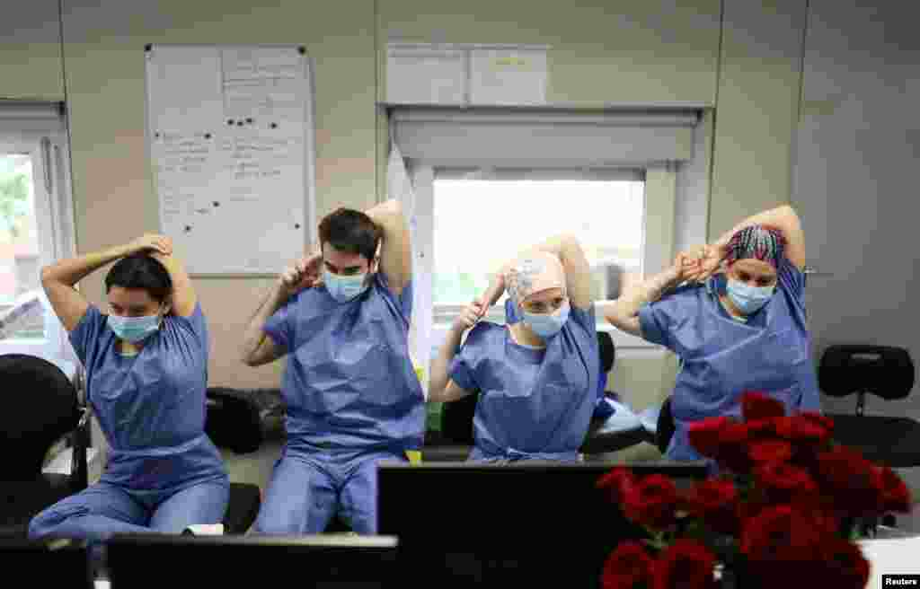 Hospital staff do yoga stretches and breathing exercises in the Intensive Care Unit at the Hospital Clinic in Barcelona, Spain.