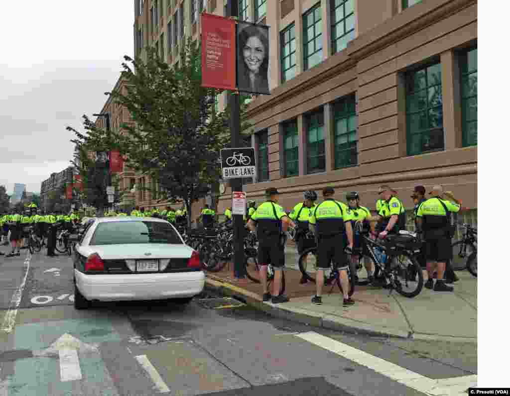 Boston Police and police from nearby districts, on bicycle patrol, getting final direction on the day's protests. City leaders have warned of zero tolerance for violence.