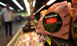 FILE - In this Sept. 6, 2011 file photo, shows a Smithfield ham at a grocery store in Richardson, Texas.