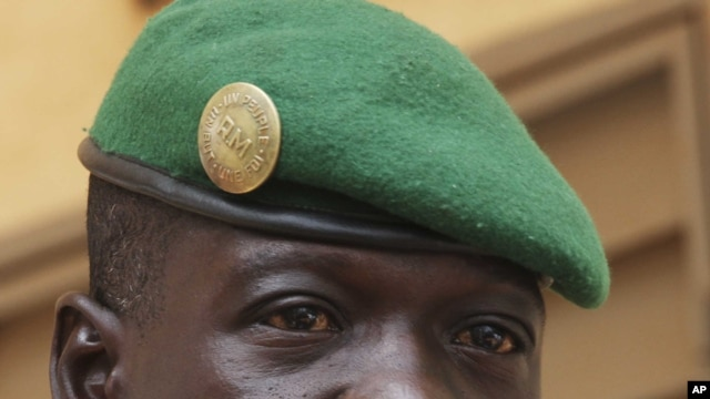 Captain Amadou Sanogo, leader of Mali's military junta, speaks during a news conference at his headquarters in Kati, outside Bamako, March 30, 2012.