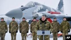 Ukrainian President Petro Poroshenko addresses the Armed Forces of Ukraine at the military airfield in Vasylkiv region, Ukraine, Dec. 1, 2018, as Poroshenko transferred new aircraft and military equipment to the Ukrainian Armed Forces.