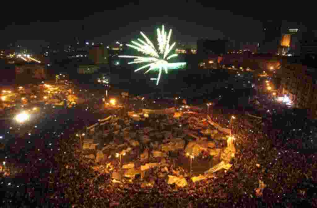 Egyptians set off fireworks as they celebrate after President Hosni Mubarak resigned and handed power to the military at Tahrir Square, in Cairo, Egypt, Friday, Feb. 11, 2011. Egypt exploded with joy, tears, and relief after pro-democracy protesters broug