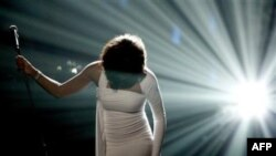 In this Sunday, Nov. 22, 2009, file photo, Artist Whitney Houston performs onstage at the 37th Annual American Music Awards in Los Angeles. Houston died Saturday, Feb. 11, 2012, she was 48. (AP Photo/Matt Sayles, File)
