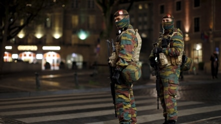 Belgian soldiers patrol in central Brussels as police searched the area during a continued high level of security following the recent deadly Paris attacks, Belgium, Nov. 23, 2015.