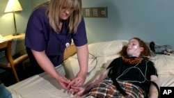 This teenager will spend the night at a sleep disorder center in Kansas City, Missouri. She is among a growing number of teens suffering from sleep disorders. (AP Photo/Charlie Riedel, 2004)