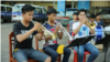 Uth Vicheka, center, practices with other trumpet players at Kolab Primary School on October 7, 2018. (Rithy Odom/VOA Khmer)