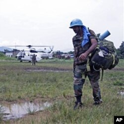UN troops walk past as they provide security for villagers at the small village of Walikale (File)